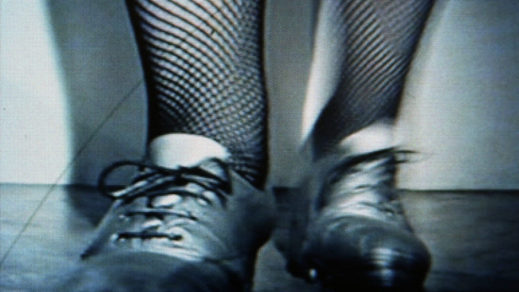 Chain Smoker, Tap Dancer. 1995. Two-channel looped video with sound. Photo: Iain Forsyth & Jane Pollard