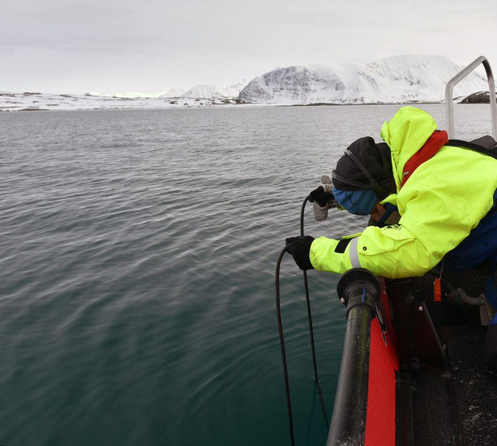 Jana Winderen hydrophone recording by Spitsbergen, Barents Sea, for the project Spring Bloom in the Marginal Ice Zone, 2016. Photo: Crew member on Helmer Hansen research vessel.
