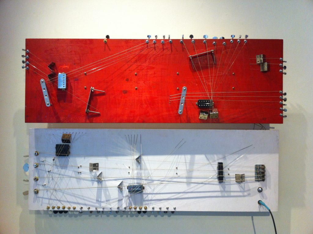 The Americans Have Colonized our Subconscious. 2014. Installation. Enamel paint, electric guitar, and bass pickup machine heads, bridge, electric guitar and bass strings on wood planks. 120cm x 39cm x 2cm (x2) Dimensions variable Photo: courtesy the artist