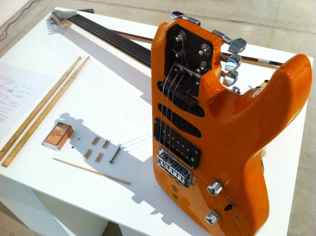 The Anti-guitar or How to Save the Electric Guitar from Brainless Rock Stars of the 21st Century. 2013. Installation Sawed off electric guitar, with additional tuning pegs and fixed bridge; violin bow; drum sticks; small wooden peg.  Dimensions variable Photo: courtesy the artist